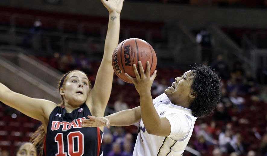 Washington's Jazmine Davis, right, shoots against Utah's Nakia Arquette (10) in the second half of a first round NCAA college basketball game in the Pac-12 women's tournament Thursday, March 5, 2015, in Seattle. Washington won 75-64. (AP Photo/Elaine Thompson)