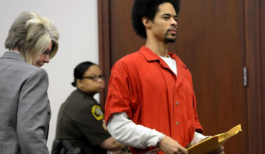 Marquay McCoy, 20, right, looks back toward his family in court in Lansing, Mich., Friday, March 6, 2015. McCoy faces a minimum of 32 years in prison and up to a life sentence after he pleaded guilty to second degree murder and armed robbery in the January 2014 shooting death of Dominique Nolff, 20, in a Cedar Street apartment in East Lansing near Michigan State University's campus. Nolff was an MSU sophomore. (AP Photo/The State Journal, Rod Sanford)  NO SALES