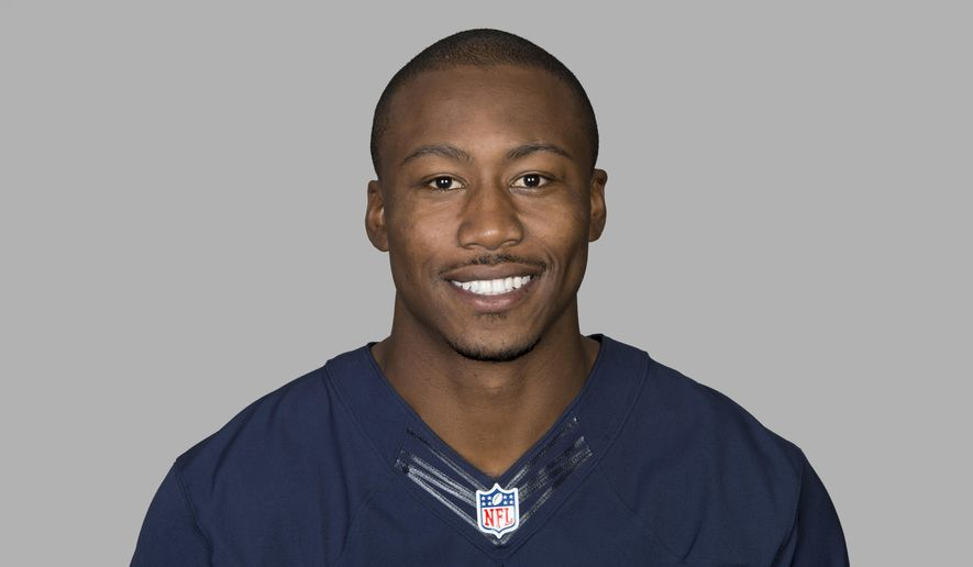 FILE - This is a 2014, file photo showing Brandon Marshall of the Chicago Bears NFL football team. A person familiar with the deal says the New York Jets have agreed to acquire star wide receiver Brandon Marshall from the Chicago Bears, pending a physical exam. The trade Friday, March 6, 2015, the first by new Jets general manager Mike Maccagnan, is for an unspecified draft pick, according to the person who spoke to The Associated Press on condition of anonymity because neither team had announced the deal.  (AP Photo/File)