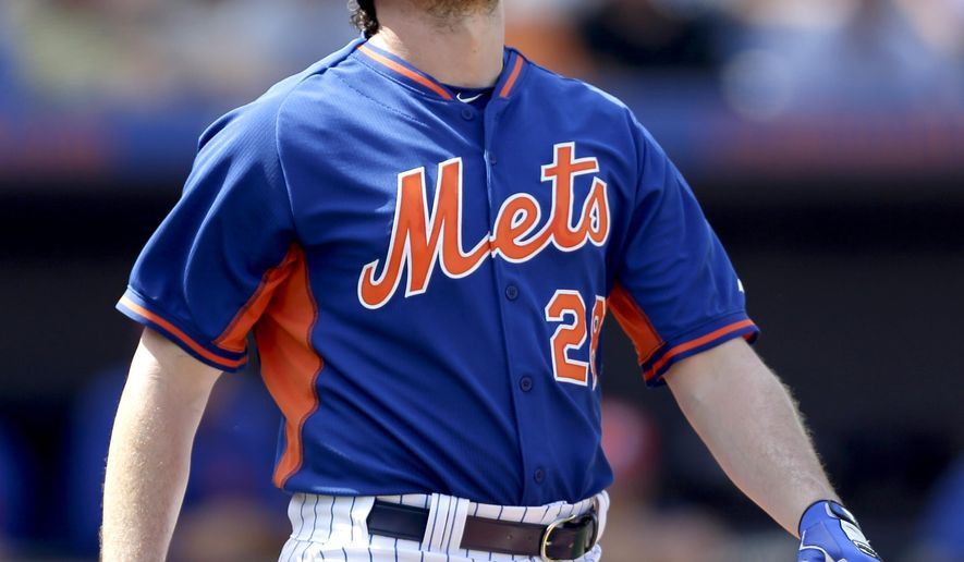 New York Mets' Daniel Murphy grimaces after being hit by a pitch during the second inning of an exhibition spring training baseball game against the Detroit Tigers Friday, March 6, 2015, in Port St. Lucie, Fla. Murphy was able to stay in the game. (AP Photo/Jeff Roberson)