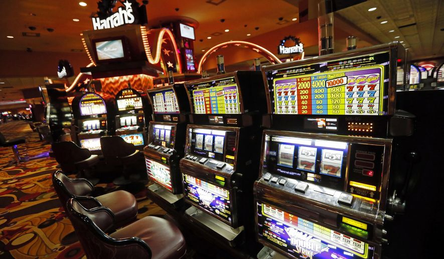 "FILE - In this May 12, 2014 file photo, legions of slot machines have few customers at Harrah's Tunica casino in Robinsonville, Miss., prior to being shut down in June. A division of Caesars Entertainment Corp. is asking a federal bankruptcy judge for permission to ""dismantle and liquidate"" part of its shuttered Harrah's casino complex in Mississippi's Tunica County.  (AP Photo/Rogelio V. Solis, File)"