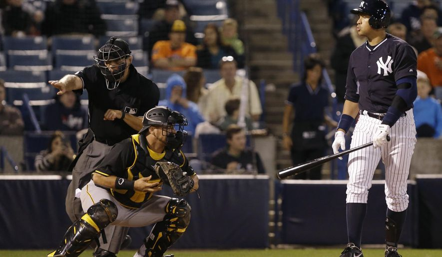 New York Yankees' Alex Rodriguez, right, reacts as home plate umpire Mark Carlson, left, calls strike three during the Yankees' spring training baseball game against the Pittsburgh Pirates, Friday, March 6, 2015, in Tampa, Fla. (AP Photo/Lynne Sladky)