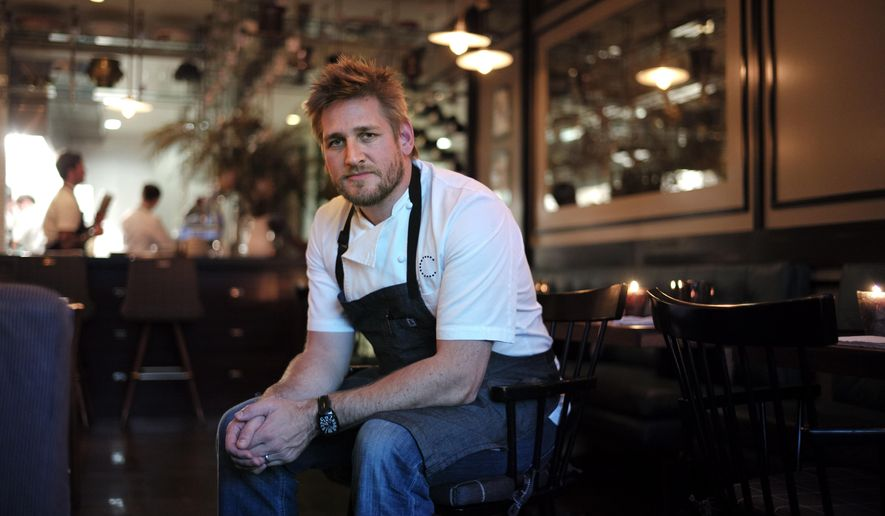 Chef Curtis Stone pauses for photos at Maude, a 25-seat restaurant he opened last year, Thursday, March 5, 2015, in Beverly Hills, Calif. Last year, the Australian chef opened the Beverly Hills restaurant (named after his grandmother) that selects one seasonal ingredient per month to infuse into a nine-course meal. (AP Photo/Jae C. Hong)