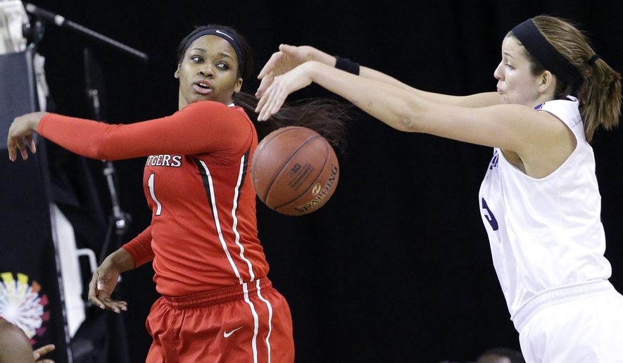 Rutgers center Rachel Hollivay, left, battles for a rebound against Northwestern forward/center Alex Cohen during the first half of an NCAA college basketball game in the quarterfinals of the Big Ten Conference tournament in Hoffman Estates, Ill., on Friday, March 6, 2015. (AP Photo/Nam Y. Huh)