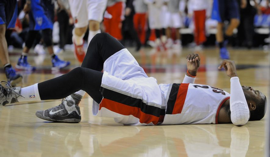 Portland Trail Blazers' Wesley Matthews after injuring his left achilles against the Dallas Mavericks during the second half of an NBA basketball game in Portland, Ore., Thursday, March 5, 2015. The Trail Blazers beat the Mavericks 94-75. (AP Photo/Greg Wahl-Stephens)