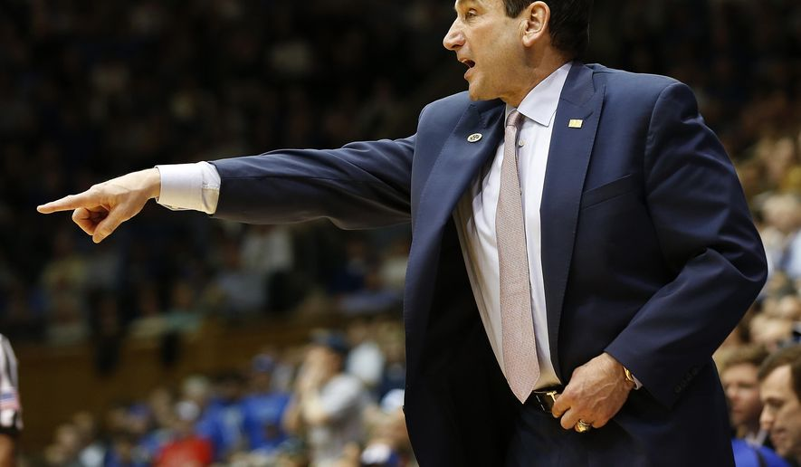 Duke coach Mike Krzyzewski gives instructions to his team during the second half of an NCAA college basketball game against Wake Forest on Wednesday, March 4, 2015, in Durham, N.C. (AP Photo/Ellen Ozier)