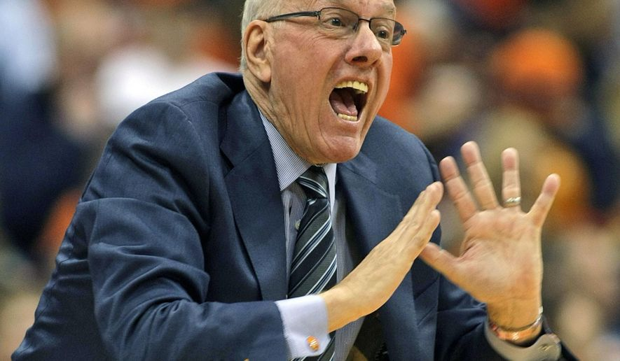 FILE - In this Dec. 6, 2014, file photo, Syracuse head coach Jim Boeheim yells to his players in the second half of an NCAA college basketball game against St. John's in Syracuse, N.Y. The NCAA has suspended Syracuse coach Jim Boeheim Friday, March 6, 2015, for nine games for academic, drug and gifts violations committed primarily by the men's basketball program.(AP Photo/Nick Lisi, File)