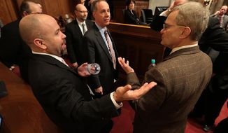 Wisconsin Assembly Minority Leader Peter Barca, D-Kenosha, right, talks with Assembly Speaker Robin Voss, R-Rochester, center, and Assembly Majority Leader Jim Steineke, R-Kaukauna, left, during a break in a debate on right-to-work legislation at the state Capitol in Madison, Wis., Thursday, March 5, 2015. (AP Photo/Wisconsin State Journal, John Hart)