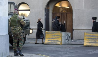 Armed soldiers patrol near a synagogue in Antwerp, Belgium on Jan. 17, 2015, as authorities rushed to preempt attacks by Islamic extremists, a day after anti-terror raids across Western Europe. (AP Photo/Virginia Mayo)