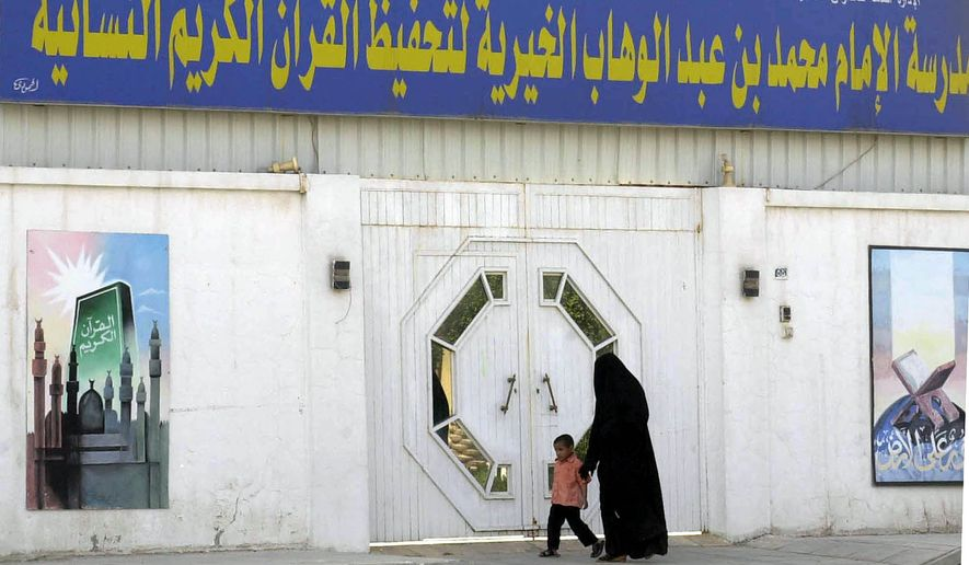 "Above: a school in Riyadh, Saudi Arabia named after Muhammad ibn Abdel-Wahhab, the 18th-century cleric whose intolerant brand of Islam (""Wahhabism"") is the state religion of the kingdom. (AP Photo/Hasan Jamali)"