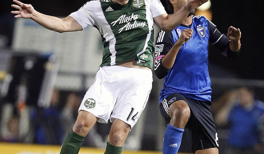FILE - In this Saturday, Oct. 4, 2014 file photo, Portland Timbers midfielder Ben Zemanski, left, goes for a header against San Jose Earthquakes forward Chris Wondolowski, right, during the first half of an MLS soccer game in Santa Clara, Calif. The emphasis for the Portland Timbers in the offseason was on shoring up the defense.The team, which was known for its defense in its first season under Caleb Porter in 2013, struggled last season, allowing 52 goals, Friday, March 6, 2015. (AP Photo/Tony Avelar< File)