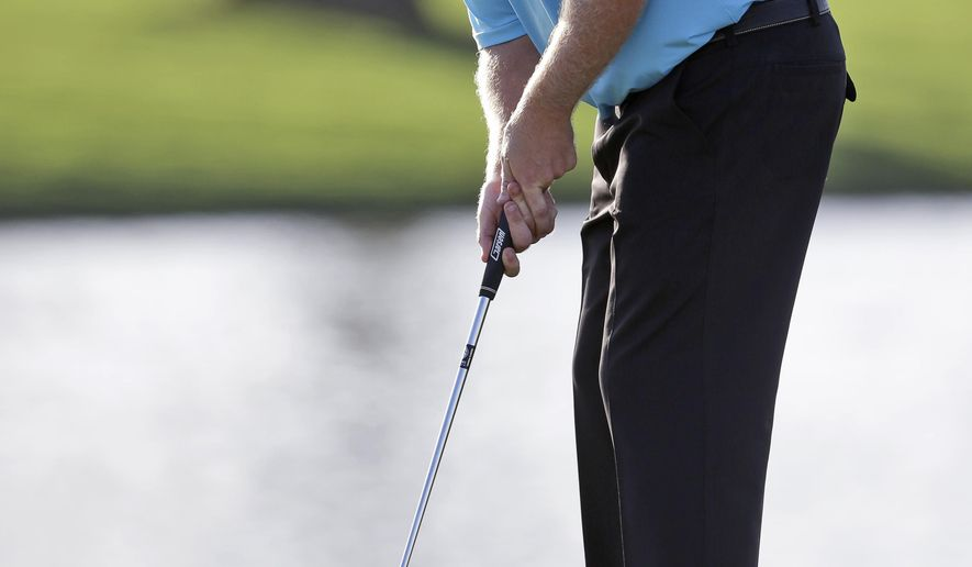 J.B. Holmes putts on the ninth hole during the first round of the Cadillac Championship golf tournament, Thursday, March 5, 2015, in Doral, Fla. (AP Photo/Wilfredo Lee)