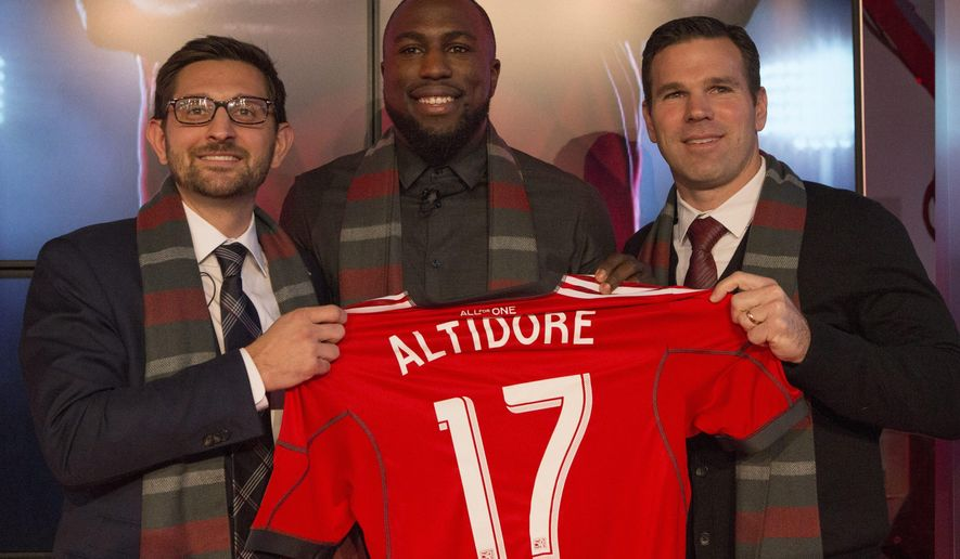 FILE - In this Jan. 16, 2015, file photo, Jozy Altidore, center, poses for a photo with Major League Soccer team Toronto FC's general manager Tim Bezbatchenko, left, and head coach Greg Vanney following a news conference where he was introduced as the teams latest signing in Toronto. Altidore has scored 25 goals with the u.S. national team and was a member of the 2010 and 2014 FIFA World Cup teams. (AP Photo/The Canadian Press, Chris Young, File)