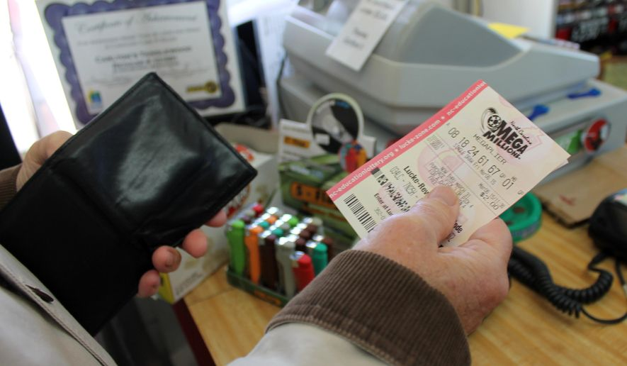 A customer at Carlton's convenience store in Clemmons, N.C., purchases a lottery ticket on Friday, March 6, 2015. Legislation being considered by the N.C. General Assembly would give winners of significant lottery cash prizes the option of remaining anonymous. (AP Photo/Skip Foreman)