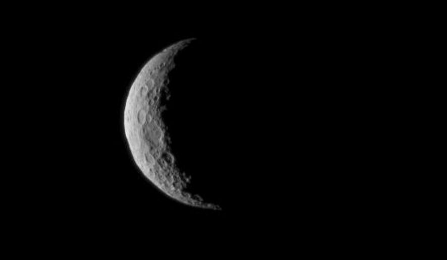 This March 1, 2015 photo provided by NASA shows Ceres is seen from NASA's Dawn spacecraft just a few days before the mission achieved orbit around the previously unexplored dwarf planet to begin a 16-month exploration. The image was taken at a distance of about 30,000 miles. (AP Photo/NASA)
