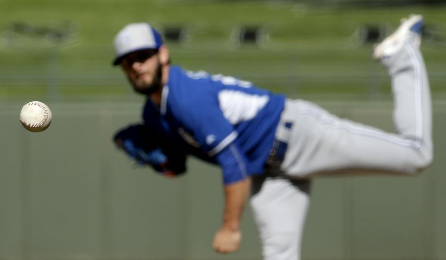 Kansas City Royals reliever Tim Collins watchea a pitch during the fifth inning of a spring training baseball game against the Texas Rangers on Wednesday, March 4, 2015, in Surprise, Ariz. (AP Photo/Charlie Riedel)