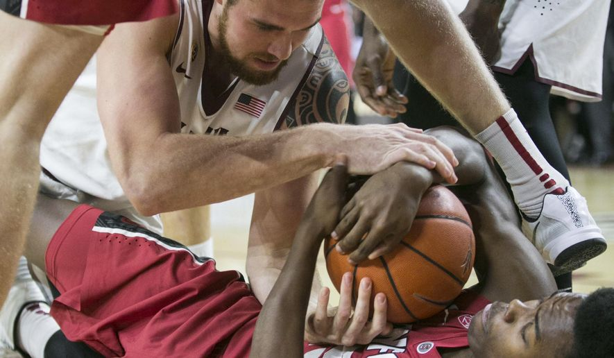 Arizona State's Eric Jacobsen fights for a loose ball with Stanford's Chasson Randle, bottom, during an NCAA college basketball game Thursday, March 5, 2015, in Tempe, Ariz. (AP Photo/The Arizona Republic, Patrick Breen)