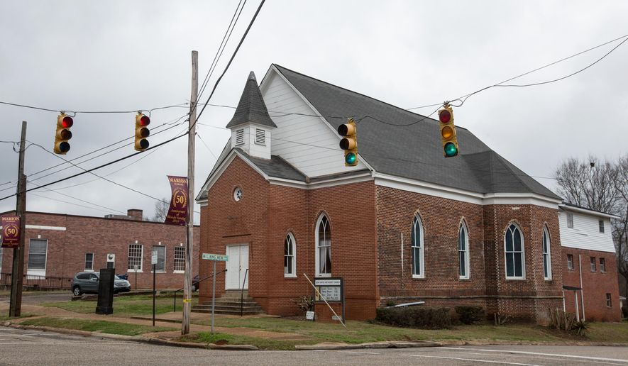 Zion United Methodist Church in Marion, Ala., was the meeting point for those who marched on the Perry County Jail on Feb. 18, 1965, to protest the arrest of a civil rights worker. The peaceful march turned violent when Alabama State Troopers began beating marchers, killing a young Baptist deacon named Jimmie Lee Jackson. Jackson's death prompted Southern Christian Leadership Conference leaders to organize the Selma to Montgomery marches, which greatly influenced the passage of the Voting Rights Act of 1965, prohibiting racial discrimination in the electoral process. On March 1, 1965, Dr. Martin Luther King Jr. gave a eulogy for Jackson at the church. (AP Photo/The Casper Star-Tribune, Ryan Dorgan)
