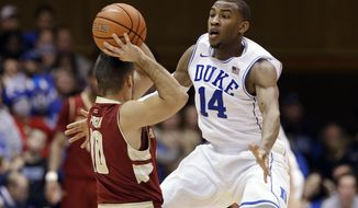 "FILE - In this Jan. 3, 2015, file photl, Duke's Rasheed Sulaimon (14) guards Boston College's Steve Perpiglia during an NCAA college basketball game in Durham, N.C. Duke coach Mike Krzyzewski dismissed Sulaimon in January for being ""unable to consistently live up"" to team standards. But during this week leading up to Saturday night's regular-season finale against the No. 19 Tar Heels, he is still being asked for details on why Sulaimon is gone. (AP Photo/Gerry Broome, File)"