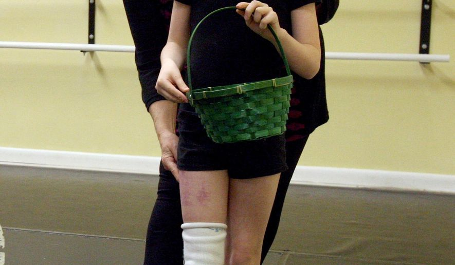 Alissa Sizemore warms up for ballet class at Powerhouse Dance Studio on Monday, March 2, 2015, in Vernal, Utah. Alissa, 8, had her right leg amputated below the knee in May 2014 after her foot was pinned under a UPS truck.  (AP Photo/The Deseret News, Geoff Liesik)  SALT LAKE TRIBUNE OUT;  MAGS OUT