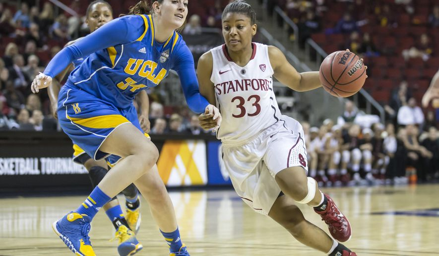 Stanford's Amber Orrange, right, drive to the basket as UCLA's Corinne Costa defends during the first half of an NCAA college basketball game in the quarterfinals of the Pac-12 Conference tournament, Friday, March 6, 2015, in Seattle. (AP Photo/Stephen Brashear)