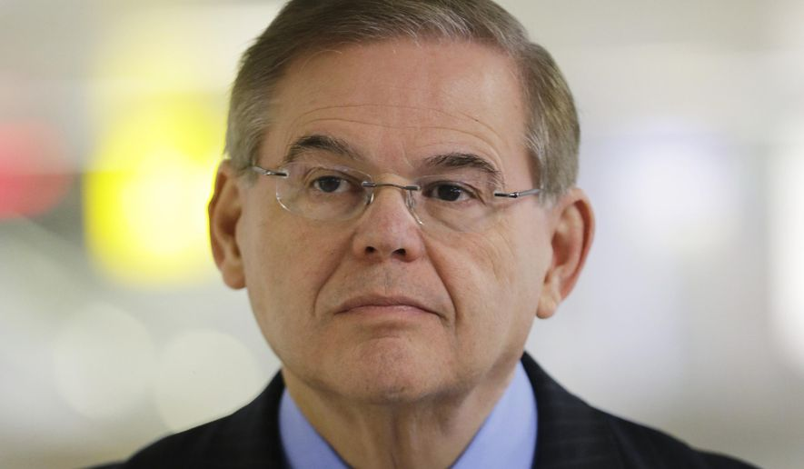 FILE - In this March 1, 2013, file photo, Sen. Robert Menendez listens during a news conference, at Newark Liberty International Airport in Newark, N.J. Attorney General Eric Holder is declining to say if he has approved the filing of corruption charges against Menendez. Nor is Menendez shedding much light on the situation. A statement issued by the senator's office Friday, March 6, 2015, says many false allegations have been made about his ties with Dr. Salomon Melgen, who is a friend and donor to Menendez's campaigns. (AP Photo/Mel Evans, File)