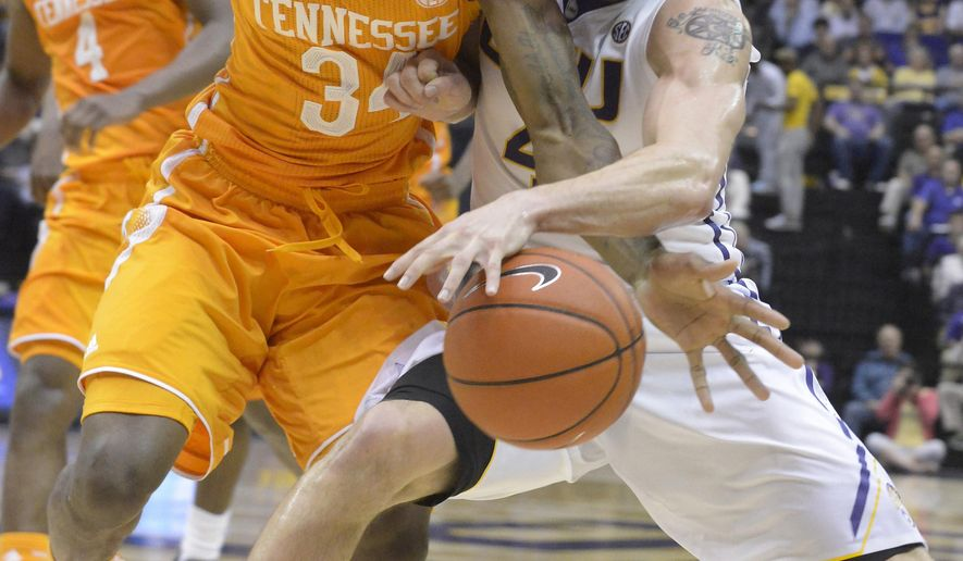 Tennessee's Devon Baulkman gets knocked out of bounds by LSU's Keith Hornsby as he tries to take control of the ball during an NCAA college basketball game Wednesday, March 4, 2015, in Baton Rouge, La. (AP Photo/The Advocate, Heather McClelland)   MAGS OUT; INTERNET OUT; NO SALES; TV OUT; NO FORNS; LOUISIANA BUSINESS INC. OUT (INCLUDING GREATER BATON ROUGE BUSINESS REPORT, 225, 10/12, INREGISTER, LBI CUSTOM); MANDATORY CREDIT