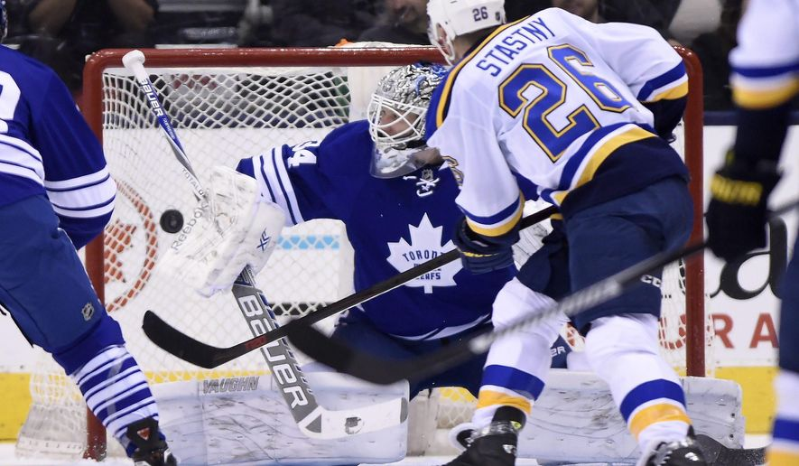 St. Louis Blues' Paul Stastny (26) scores against the Toronto Maple Leafs during the second period of an NHL hockey game Saturday, March 7, 2015, in Toronto. (AP Photo/The Canadian Press, Frank Gunn)