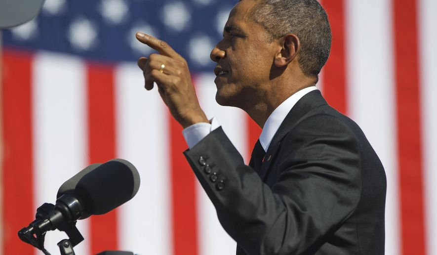 """President Barack Obama speaks near the Edmund Pettus Bridge in Selma, Ala., for the 50th anniversary of """"Bloody Sunday,"""" a landmark event of the civil rights movement, Saturday, March 7, 2015. (AP Photo/Jacquelyn Martin)"""