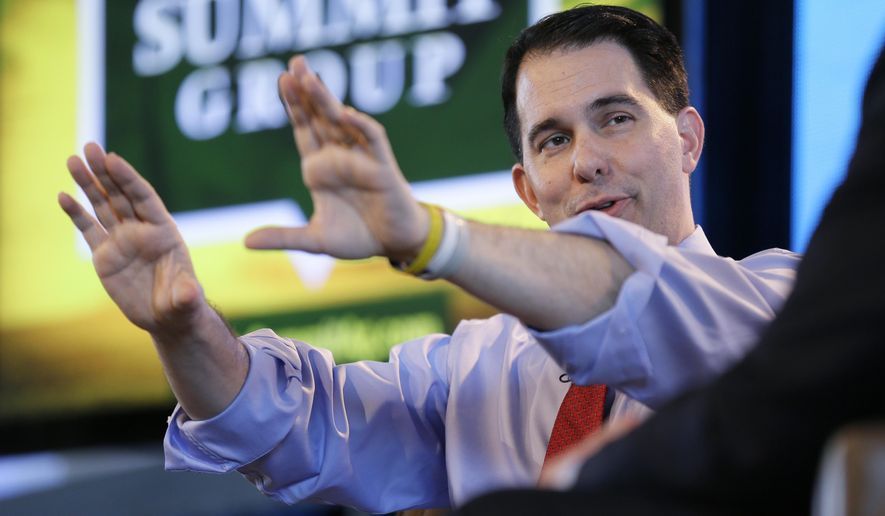 Wisconsin Gov. Scott Walker speaks during the Iowa Agriculture Summit, Saturday, March 7, 2015, in Des Moines, Iowa. (AP Photo/Charlie Neibergall)
