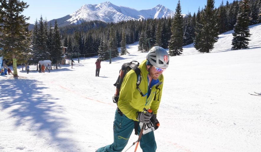 In this SAturday, Feb. 28, 2015 photo, Kevin Oberheim begins a climb during the Jack'n'Jill Randonee Race at Teton Pass Ski Resort, in Choteau, Mont. Randonee races challenge skiers to climb up a slope using their own power and then ski down a set course. (AP Photo/The Great Falls Tribune, Erin Madison)