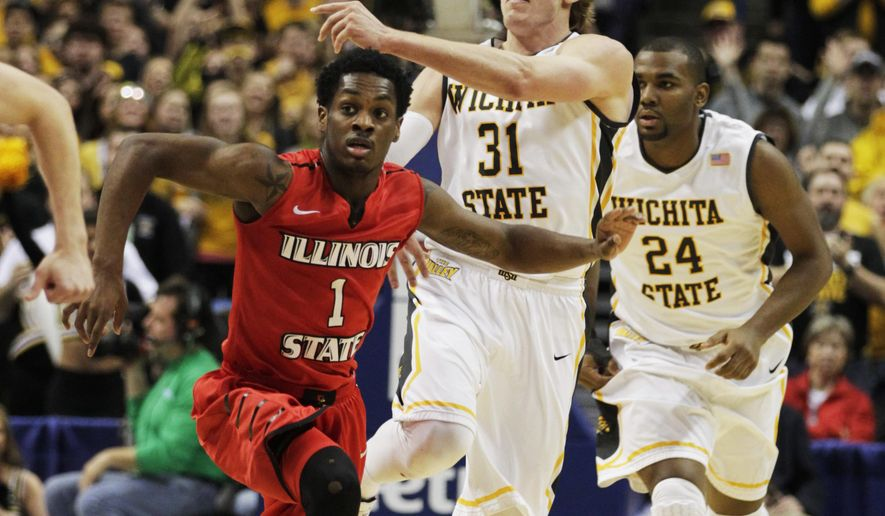 Wichita State's Ron Baker (31) passes over the head of Illinois State's Paris Lee (1) in the first half of an NCAA college basketball game in the semifinals of the Missouri Valley Conference tournament, Saturday, March 7, 2015, in St. Louis. (AP Photo/Tom Gannam)