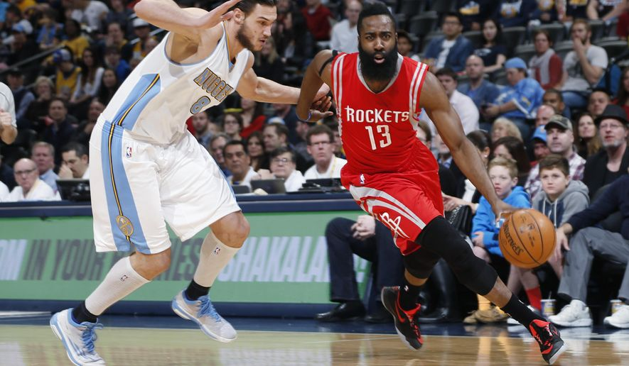 Houston Rockets guard James Harden, right, drives for a shot past Denver Nuggets forward Danilo Gallinari, of Italy, during the first quarter of an NBA basketball game Saturday, March 7, 2015, in Denver. (AP Photo/David Zalubowski)