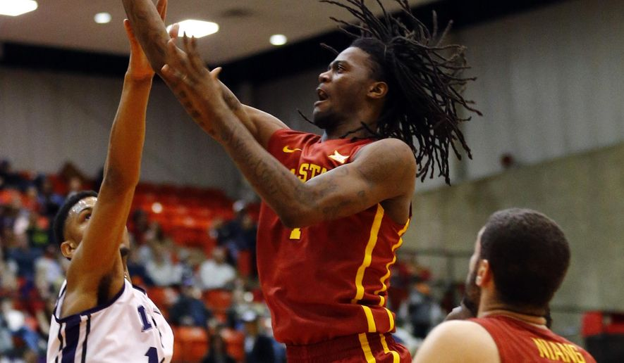 Iowa State forward Jameel McKay, center, shoots as TCU center Karviar Shepherd (14) defends and Iowa State guard Georges Niang (31) watches during the first half of an NCAA college basketball game, Saturday, March 7, 2015, in Fort Worth, Texas. (AP Photo/Mike Stone)