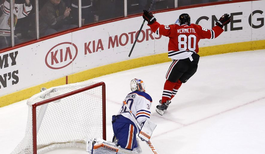 Chicago Blackhawks center Antoine Vermette (80) celebrates after scoring against Edmonton Oilers goalie Ben Scrivens to give the Blackhawks a 2-1 win during a shootout period of an NHL hockey game Friday, March 6, 2015, in Chicago. (AP Photo/Charles Rex Arbogast)