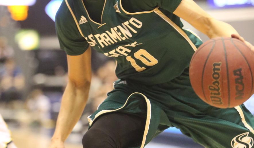 Sacramento State's Mikh McKinney (10) moves the ball up court during an NCAA college basketball game against Northern Arizona in Flagstaff, Ariz., Saturday, March 7, 2015. (AP Photo/Arizona Daily Sun, Taylor Mahoney)