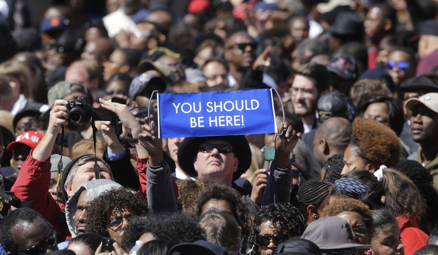 """A large crowd gathers near a stage where President Barack Obama will speak and then take a symbolic walk across the Edmund Pettus Bridge, Saturday, March 7, 2015, in Selma, Ala. This weekend marks the 50th anniversary of """"Bloody Sunday,' a civil rights march in which protestors were beaten, trampled and tear-gassed by police at the Edmund Pettus Bridge, in Selma. (AP Photo/Gerald Herbert)"""