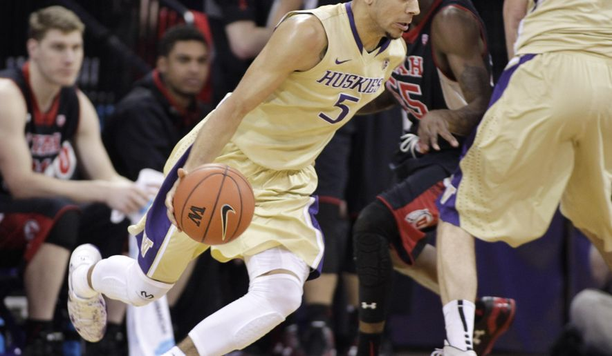 Washington's Nigel Williams-Goss drives against Utah in the first half of an NCAA college basketball game on Saturday, March 7, 2015, in Seattle. (AP Photo/John Froschauer)