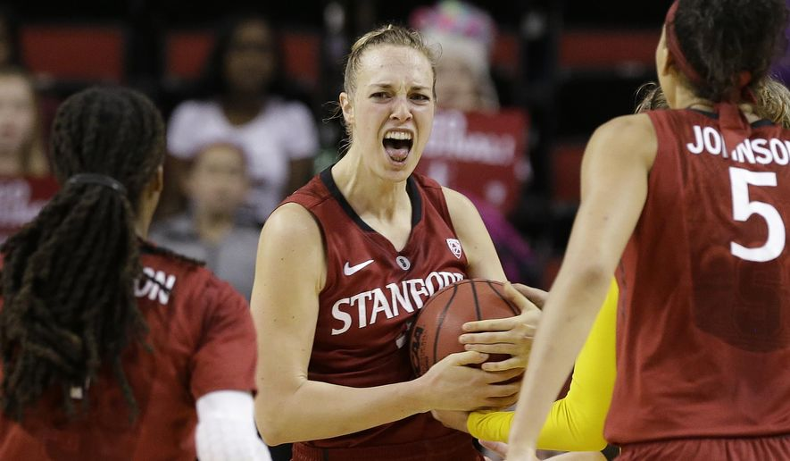 Stanford's Taylor Greenfield reacts after grabbing a rebound on a missed Stanford free throw in the final seconds of an NCAA college basketball game in the semifinals of the Pac-12 Conference tournament Saturday, March 7, 2015, in Seattle. Stanford won 59-56. (AP Photo/Elaine Thompson)