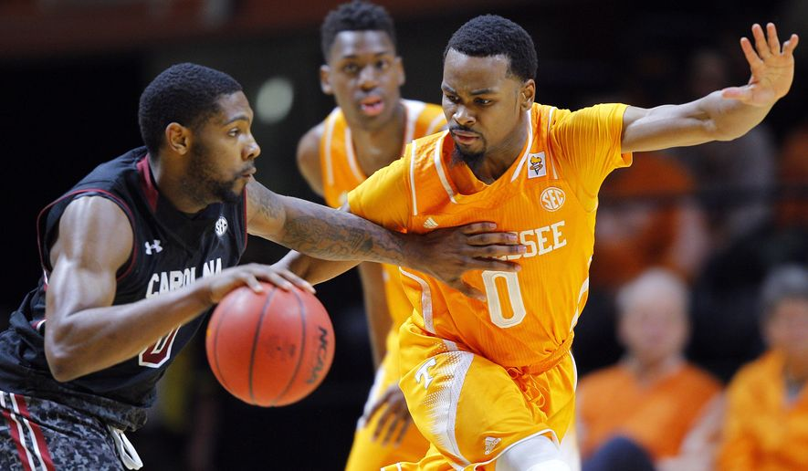 South Carolina guard Sindarius Thornwell drives against Tennessee defender Kevin Punter during an NCAA college basketball game Saturday, March 7, 2015, in Knoxville, Tenn. South Carolina won 60-49, ending a 15-game losing streak to Tennessee. (AP Photo/Knoxville News Sentinel, Wade Payne)