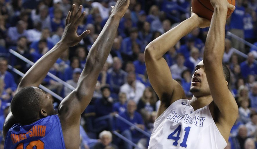 Kentucky's Trey Lyles (41) shoots while pressured by Florida's Dorian Finney-Smith (10) during the first half of an NCAA college basketball game, Saturday, March 7, 2015, in Lexington, Ky. (AP Photo/James Crisp)
