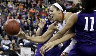Maryland center Brionna Jones, center, reaches for the ball against Northwestern guard Karly Roser, left, and forward Lauren Douglas during the second half of an NCAA college basketball game in the semifinals of the Big Ten Conference tournament in Hoffman Estates, Ill., on Saturday, March 7, 2015. Maryland won 74-63. (AP Photo/Nam Y. Huh)