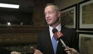 Former Maryland Gov. Martin O'Malley discusses economic issues with reporters before speaking to a banquet at Kansas Democrats' biggest annual convention, Saturday, March 7, 2015, in Topeka, Kan. (AP Photo/John Hanna) ** FILE **