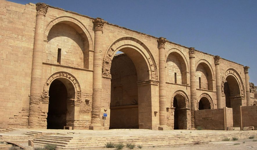 """FILE - In this  July 27, 2005 file photo, a temple to the Shamash sun god still stands over 1,750 years after the Sassanian empire razed the Mesopotamian city of Hatra, 320 kilometers (200 miles) north of Baghdad, Iraq. Iraq's minister of tourism and antiquities told The Associated Press, Saturday, March 7, 2015, that the government is investigating reports that the ancient archaeological site of Hatra in northwestern Iraq is being demolished by militants from the Islamic State group. The group has already looted artifacts from Nimrud, another ancient archaeological site, on Friday and bulldozed it in a move UNESCO deemed """"a war crime."""" (AP Photo/Antonio Castaneda, File)"""