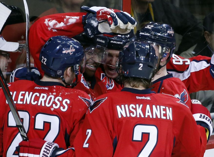 Washington Capitals right wing Joel Ward (42), second from left, celebrates his goal with teammates in the third period of an NHL hockey game against the Buffalo Sabres, Saturday, March 7, 2015, in Washington. The Capitals won 6-1. (AP Photo/Alex Brandon)