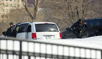 "Members of the U.S. Secret Service's Counter Assault Team are visible near their vehicles on the North Lawn of the White House, Saturday, March 7, 2015, in Washington. President Barack Obama and the first family were to travel Saturday to Selma, Ala., for the 50th anniversary of ""Bloody Sunday,"" a landmark event of the civil rights movement. (AP Photo/Pablo Martinez Monsivais)"