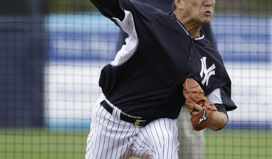 New York Yankees starting pitcher Masahiro Tanaka, of Japan, throws during a simulated game at a spring training baseball workout, Saturday, March 7, 2015, in Tampa, Fla. (AP Photo/Lynne Sladky)