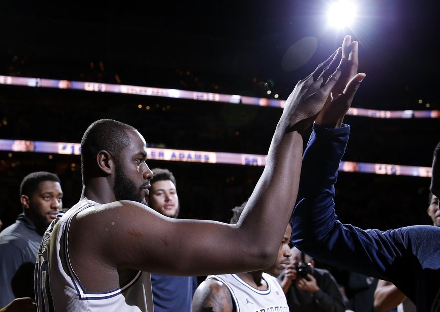 Georgetown center Tyler Adams, left, sheds a tear as he is introduced before an NCAA college basketball game against Seton Hall, Saturday, March 7, 2015, in Washington. Adams started, and hasn't played in a game since 2011, sidelined because of a heart ailment. (AP Photo/Alex Brandon)