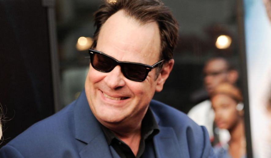 """FILE - In this July 21, 2014 file photo, Dan Aykroyd attends the world premiere of """"Get On Up"""" in New York. Aykroyd plans to make a donation to the family of a Philadelphia police officer killed in the line of duty. KYW-TV reports the actor made the announcement while visiting the Philadelphia Flower Show to promote his vodka company on Friday, March 6, 2015. (Photo by Evan Agostini/Invision/AP, File)"""
