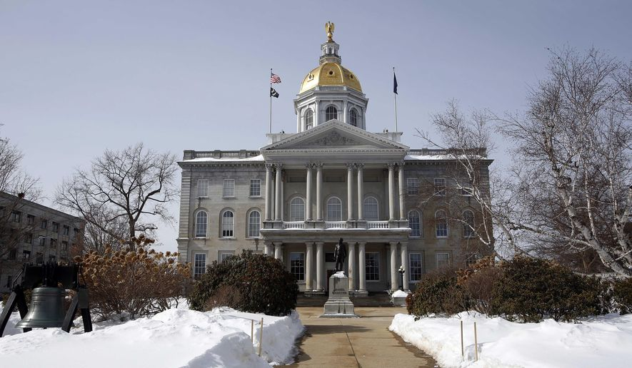 In this photo taken Tuesday March 3, 2015 the New Hampshire Statehouse is seen in Concord, N.H. An effort is underway to keep the Statehouse open on the weekends for visitors and tour groups. (AP Photo/Jim Cole)
